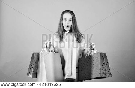 Kid Fashion. Shop Assistant With Package. Sales And Discounts. Small Girl With Shopping Bags. Happy