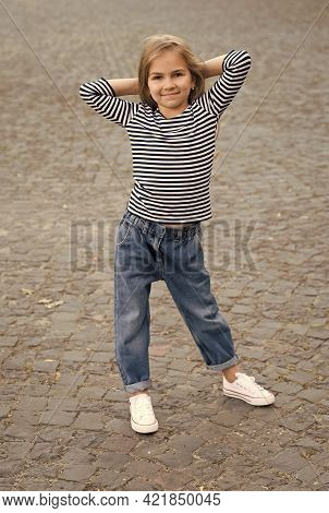 Style And Posture That Grabs Everyones Attention. Little Kid Wear Casual Style Outdoors. Fashion Gir