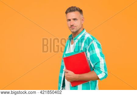 Adult Man Student Holding Notebooks. Man With Folder Yellow Background. Businessman Hold Book For No
