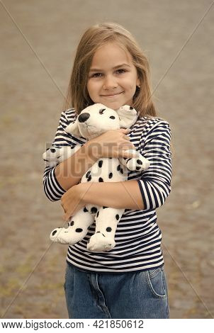 Best Friends. Happy Kid Embrace Toy Dog Outdoors. Childhood Friends. Play And Imagination. Friends A