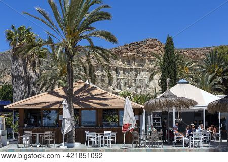 Bolnuevo, Murcia, Spain 11-05-2021 Bar Restaurant Oasis De Las Palmeras, On The Beachfront With Terr