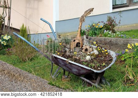 Heavily Used Retro Vintage Wheelbarrow Construction Cart Remade To Be Used As Garden Decoration With