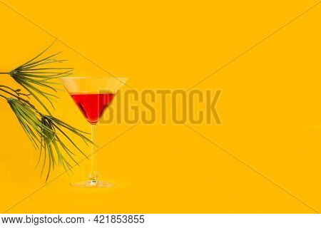 A Glass Of Red Vermouth On A Yellow Background
