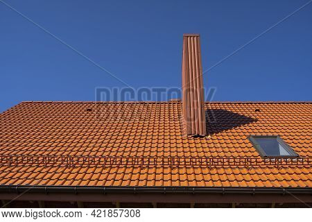 Red Corrugated Metal Profile Roof Installed On A Modern House. The Roof Of Corrugated Sheet. Roofing