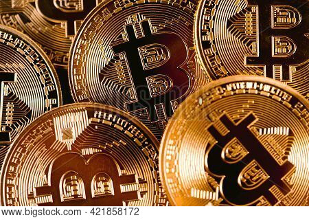 Close Up Of A Set Of Golden Bitcoins Stacked Together With Visible Logo. Cryptocurrencies Growth Con