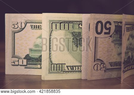 Selective Focus Of Fifty Dollar Bills And One Hundred Dollar Bills Upside Down. Details Of Us Curren