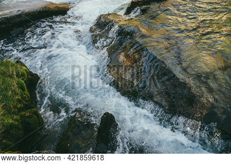 Colorful Nature Background With Big Boulder In Turbulence Of Mountain River In Sunny Day. Beautiful