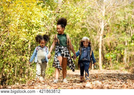 Group Family Children Checking Map For Explore And Find Directions In The Camping Jungle Nature And