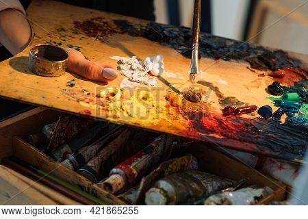 Painting Process. Artist Tools. Professional Art. Creative Mess. Female Painter Hand Mixing Oil Pain