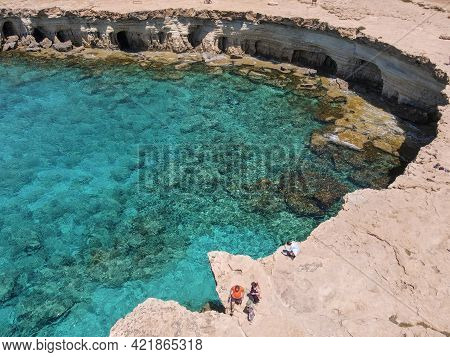 People Visiting The Coast With Caves Near Ayia Napa On Cyprus