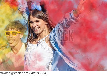 Beautiful Young Woman Hold Light Up Colored Smoke Bombs - Happy Friends Having Fun In The Park With