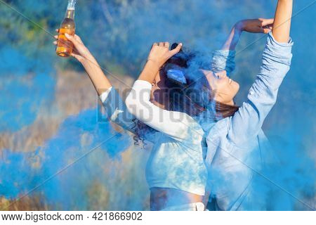 Beautiful Young Woman Dancing In Light Up Colored Smoke Bombs - Happy Friends Having Fun In The Park