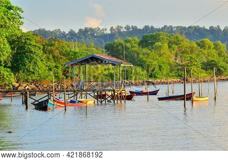 Small Wooden Jetty With Fishing Boats Moored In Tanjung Aru Village,labuan Ft,malaysia. Tanjung Aru