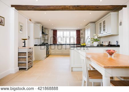 Open Plan Farmhouse Kitchen Dining Room, With Modern Painted Wood Modular Kitchen Units, Uk Interior