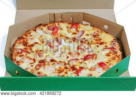 Seafood And Ham Pizza In Paper Box Packaging On White Background.