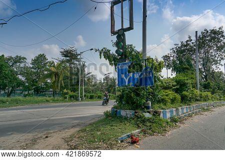 Kolkata, West Bengal, India - 23rd May 2020 : Super Cyclone Amphan Has Broken Road Sign Direction To