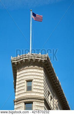 Seattle, Washington Usa - April 17, 2018. Times Square Building Flag. The Historic Times Square Buil