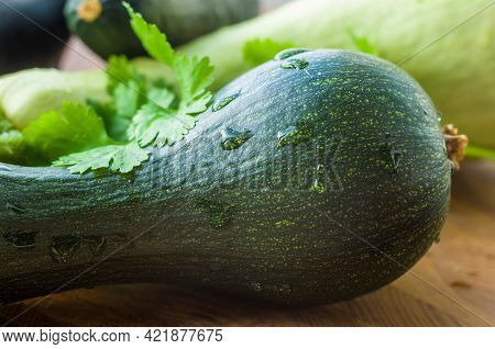 Still Life - Fresh Whole Zucchini, Eggplant And Parsley On A Wooden Board, Close Up