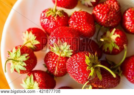 Ripe Fresh Strawberries On White Plate With Long Shadow, Close Up.