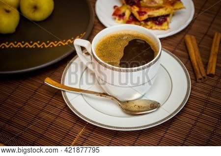 Still Life - A Hot Cup Of Black Coffee, Homemade Cookies With Fruit, Baked Apples On A Bamboo Mat
