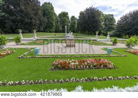 Lancut, Poland - August 26, 2020: Italian Garden - Sculpture Of Bacchus On The Panther In Front Of 1