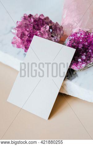 Amethyst healing crystal by a card