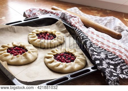 Sweet Galetts With Elderberries And Cowberries On Baking Tray Ready For Baking