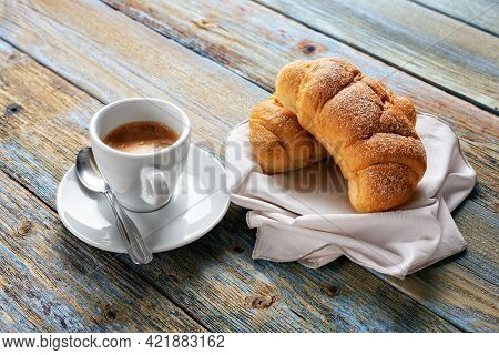 View From Above. Cup Of Hot Italian Espresso Coffee And Croissants On A Light Blue Rustic Wooden Bac