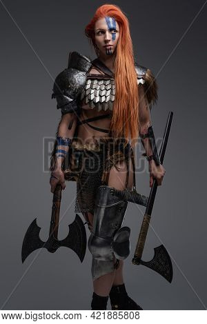 Authentic Redhead Valkyrie With Dual Axes And Muscular Build