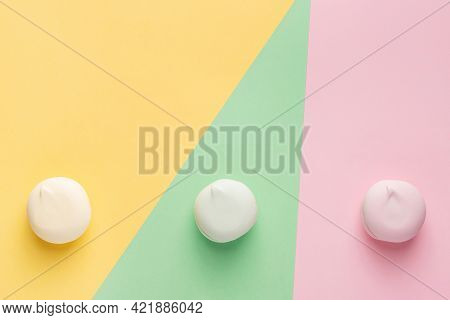 Colorful Sweets (marshmallows) On Multi Color Pastel Background. Trendy Concept With Sweet Food (rou