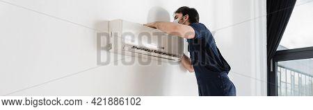 Repairman In Medical Mask Fixing Air Conditioner, Banner.