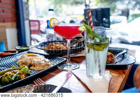 Table Full Of Amazing Modern And Elegant Food And Red Strawberry Berry Cherry Drink And A Mojito Pla