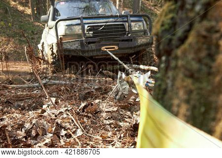 The 4x4 Off-road Car Pulls Itself Out Of The Trap With The Help Of A Winch, Clinging To A Tree. Extr