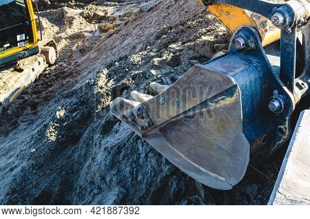 Excavator Bucket Close Up. An Excavator Working Removing Earth On A Construction Site