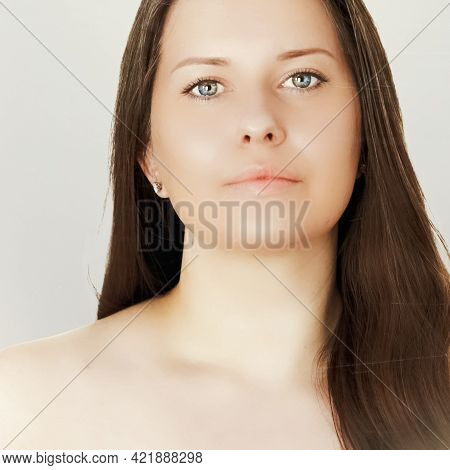 Suntan Skin Tone And Beauty Routine. Beautiful Brunette Female Model With Natural Tan, Face Portrait