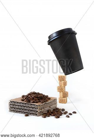 Paper Coffee Cup Levitate On A Brown Sugar Cubes Tower And A Pile Of Coffee Beans On A Piece Of Pape