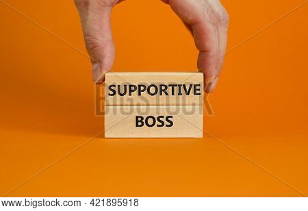Supportive Boss Symbol. Wooden Blocks With Words 'supportive Boss' On Beautiful Orange Background. B