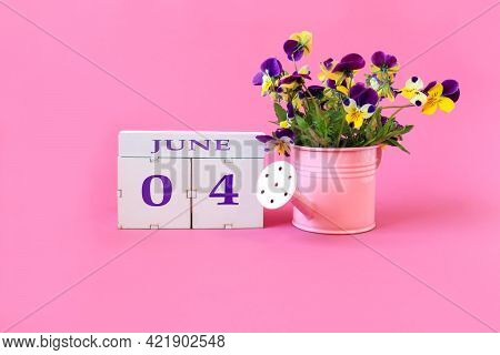 Calendar For June 4 : The Name Of The Month Of June In English, Cubes With The Numbers 0 And 4, A Bo