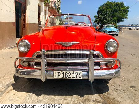 Red Cuban Vintage Car. American Old Classic Car The Road In The Center Of Havana, Cuba. April 25th,