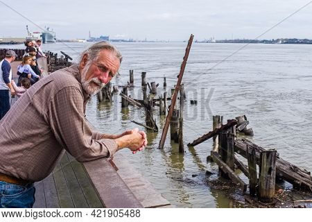 New Orleans, Louisiana - February 2, 2019: Bearded Man Above The Wreckage Of A Pier On The Mississip