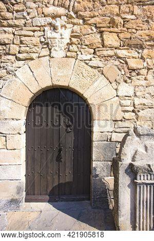Foradada, Spain, May 1, 2020 - Vintage Oak Door Castle Of Montsonis In Catalonia. Old Medieval Archi