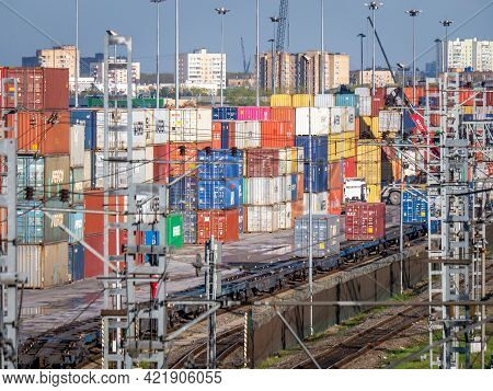 Railway Container Terminal In Moscow. Lots Of Colorful Stacked Cargo Containers Waiting For Loading