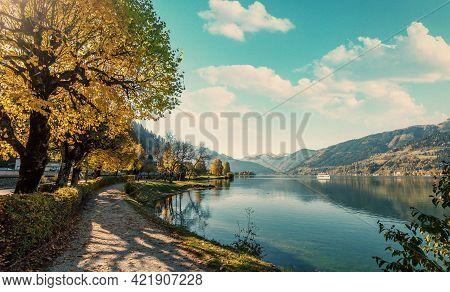 Wonderful Scenic View. Amazing Autumn Landscape Under Sunlight. Touristic  Pathway Near The Colorful