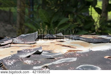 Close-up Of Peeled Body Paint From Top Of An Old Car. Selective Focus Points. Blurred Background