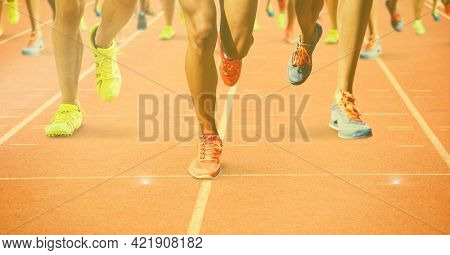 Composition of legs of athletes running on racing track. sports and competition concept digitally generated image.