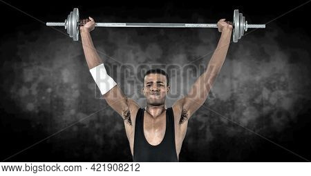 Composition of african american male weightlifter with barbell with smoke on black background. sports and competition concept digitally generated image.