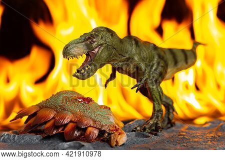 Tyrannosaurus And Stegosaurus Body In Front Of Fire