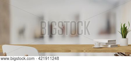 3D Rendering, Books, Cup And Plant Pot On A Wooden Table With White Chair In Blurred Background