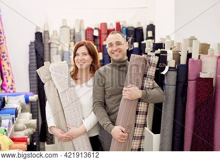Family Business Team Working Together. Couple Of Two Professional Tailors Holding Rolls Of Fabrics C