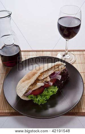 juicy fresh hot healthy pita bread with a glass of red wine